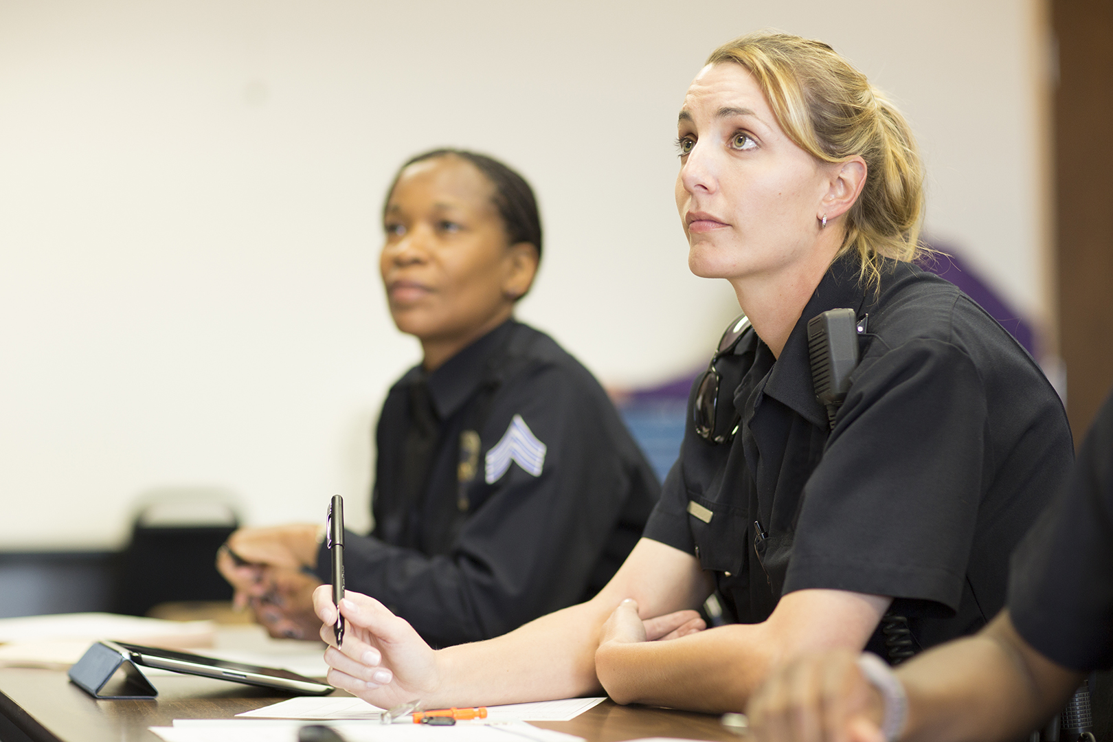 EMERGENCY SERVICES - Policewomen in classroom