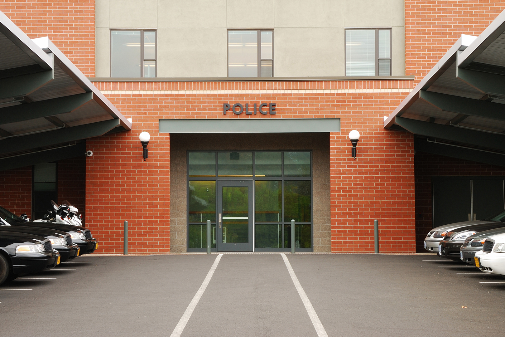 Police cruisers parked outside of a main police station in Roseburg Oregon